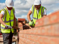 Construction firms began hiring for the first time in nearly two years in December as a surge in housebuilding helped the sector expand for the seventh month in a row, new figures show (Taylor Wimpey/PA)