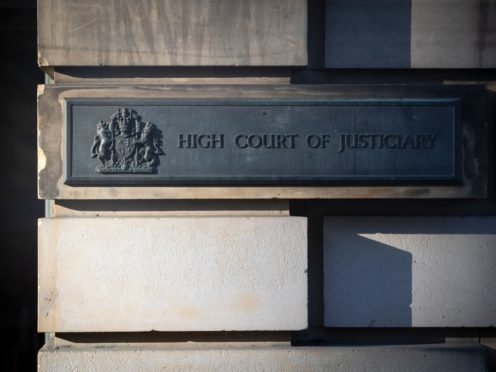 Waiting times for High Court cases have doubled (Jane Barlow/PA)
