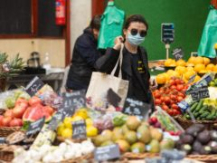 A shopper wearing a protective face mask at Borough Market in London in June 2020 (Dominic Lipinski/PA)