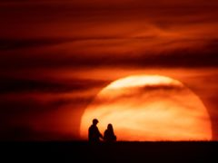 The sun sets in Chesterton, Warwickshire, as Britain is braced for a June heatwave as temperatures are set to climb into the mid-30s this week.