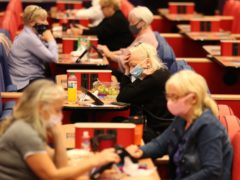 Mecca Bingo and casino owner Rank Group has warned trading at its venues is not likely to recover until the middle of next year as the pandemic sent it swinging to a half-year loss.