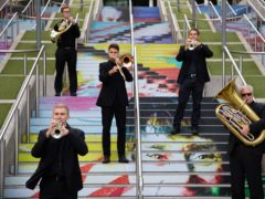 A brass quintet from the Royal Philharmonic Orchestra on the Spanish Steps in Wembley Park (David Parry/PA)