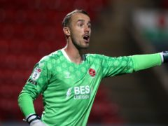 Fleetwood goalkeeper Alex Cairns kept a clean sheet at Wigan (Martin Rickett/PA)