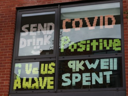 Signs on a window at Manchester Metropolitan University's Birley campus (Peter Byrne/PA)