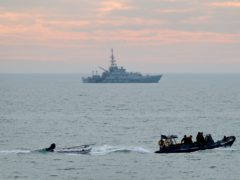 A small boat is towed by a Border Force vessel (Gareth Fuller/PA)