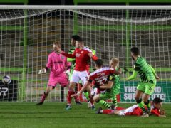 Swindon centre back Tom Broadbent (pictured centre, falling) will miss the home clash with Doncaster due to a knee injury (David Davies/PA Images).