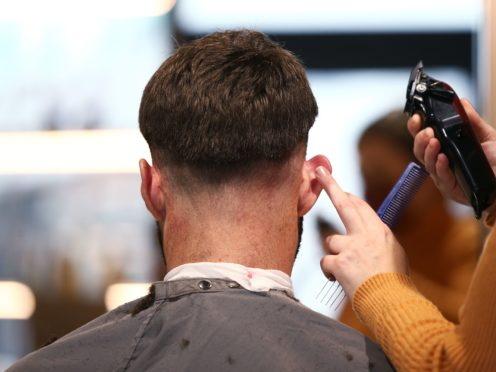 A brush with the law: 31 police officers face Covid fines for on duty hair cut (Yui Mok/PA)