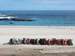 Stacked beach chairs lay on the closed beach in Camps Bay, Cape Town (Nardus Engelbrecht/AP)
