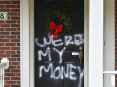 Graffiti at the home of Senate majority leader Mitch McConnell in Louisville, Kentucky (Timothy D Easley/AP)