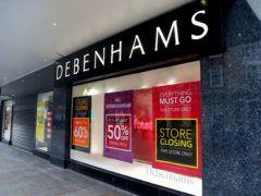 Closing down signs in the window of Debenhams in Worcester (David Davies/PA)