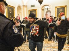 Supporters of President Donald Trump are confronted by Capitol Police officers outside the Senate Chamber at the Capitol in Washington (AP Photo/Manuel Balce Ceneta)