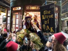 Peggy Scott Laborde and members of the Krewe of Oak toast Carnival as the Phunny Phorty Phellows start their 40th anniversary streetcar ride ushering in Carnival at the Willow Street car barn in New Orleans, (David Grunfeld/The New Orleans Advocate/AP)
