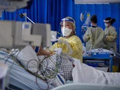 Covid daily hospital admissions drop but Health Secretary warns of NHS pressure (Victoria Jones/PA)