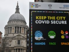Covid-19 signage in front of St Paul's Cathedral (Dominic Lipinski/PA)