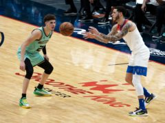 New Orleans Pelicans guard Lonzo Ball passes the ball as his brother, Charlotte Hornets guard LaMelo Ball defends during the second quarter of their NBA match in New Orleans (Derick Hingle/AP)