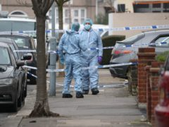 Forensic officers in Tavistock Gardens, Ilford, east London, after two men died at a property in the street (Jonathan Brady/PA)