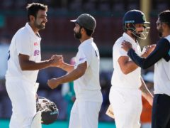 India celebrate after holding Australia to a draw in the third Test (Rick Rycroft/AP)