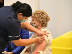 Moira Edwards receives an injection of the Oxford/AstraZeneca Covid-19 vaccine at Epsom in Surrey (Dominic Lipinski/PA)