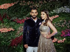 Indian cricketer Virat Kohli, left, and Bollywood actress Anushka Sharma (Rajanish Kakade/AP)