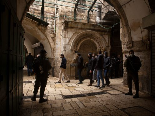 Israeli police watch worshippers leave at the Dome of the Rock Mosque in the Al Aqsa Mosque compound in the Old City of Jerusalem (Maya Alleruzzo/AP)