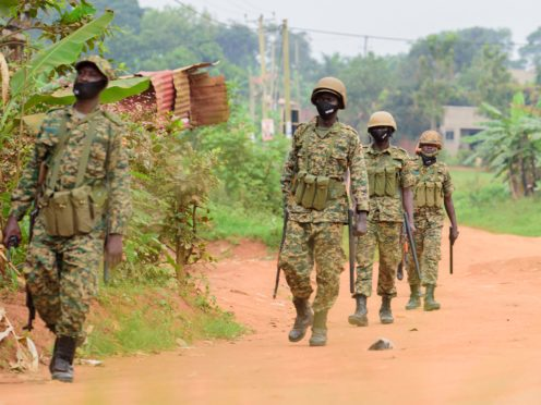 Soldiers on patrol outside opposition leader Bobi Wine's home in Kampala (Nicholas Bamulanzeki/AP)