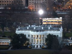The White House is seen from the Washington Monument (Jon Raedle/AP)