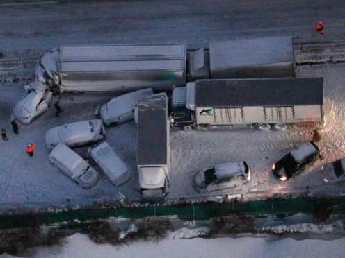 Damaged cars covered with snow after a multi-vehicle accident (Yuta Omori/Kyodo News via AP)