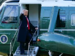 President Donald Trump gestures as he boards Marine One on the South Lawn of the White House (Alex Brandon/AP)