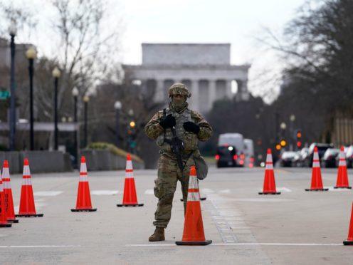 A National Guardsman stands near the US Supreme Court (AP/Gerald Herbert)