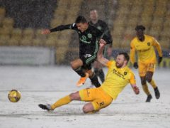 Mohamed Elyounoussi is challenged by Livingston's Nicky Devlin (Andrew Milligan/PA)