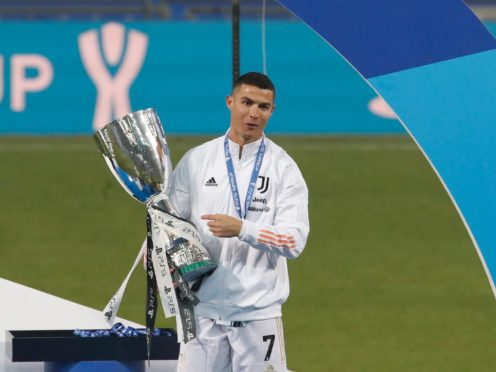 Cristiano Ronaldo celebrates winning the Italian Super Cup (Antonio Calanni/AP))