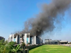 Smoke rises from the Serum Institute of India, the world's largest vaccine maker that is manufacturing the AstraZeneca/Oxford University vaccine, in Pune, India (Rafiq Maqbool/AP)