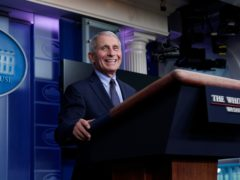 Dr Anthony Fauci laughs while speaking in the press room at the White House (Alex Brandon/AP)