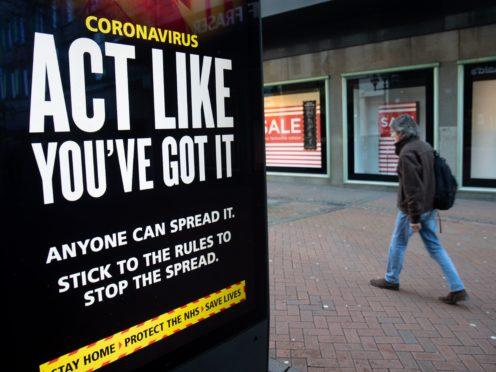 Government coronavirus sign (Andrew Matthews/PA)