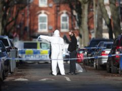 Forensics officers at the scene in Linwood Road, Handsworth (David Davies/PA)