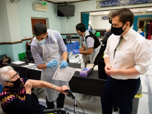 Robert Jenrick visited Al-Abbas Islamic Centre in Birmingham, where a Covid-19 vaccination centre has been set up (Jacob King/PA)