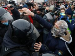 Police detain a man during a protest against the jailing of opposition leader Alexei Navalny in Moscow (AP)