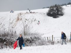 People sledging on Wychbury Hill in Hagley, Worcestershire (PA)