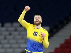 St Johnstone's Shaun Rooney celebrates scoring his side's second goal (Jeff Holmes/PA)