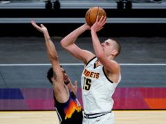 Nikola Jokic, right, snatched 29 points and 22 rebounds as his Denver Nuggets pushed past the Phoenix Suns 120-112 (Rick Scuteri/AP)