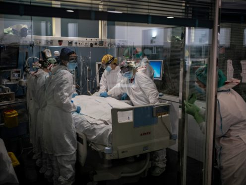 A Covid-19 patient receives treatment in the ICU of the Hospital del Mar in Barcelona, Spain, (Felipe Dana/AP)