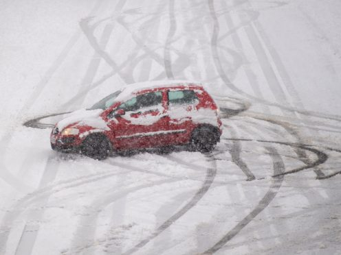Parts of the UK woke up to almost seven inches of snow, the Met Office said (Joe Giddens/PA)