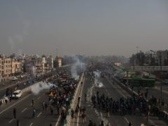 Police in New Delhi use tear gas to disperse farmers who marched to the capital during India's Republic Day celebrations (Altaf Qadri/AP)
