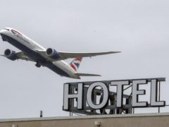Travellers returning to the UK returning from 'red list' countries will be sent to quarantine hotels for 10 days, Boris Johnson has announced (Steve Parsons/PA)