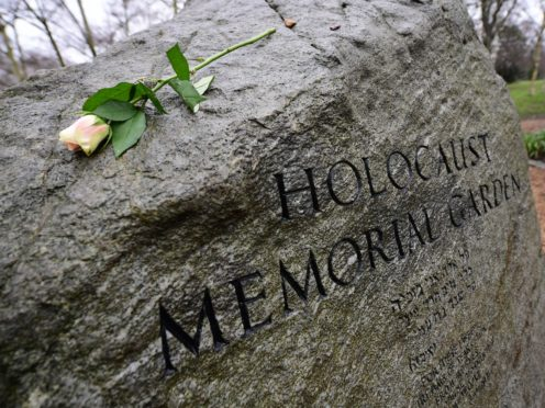 A rose is placed on the stone in the Holocaust Memorial Garden in Hyde Park, London (Ian West/PA)