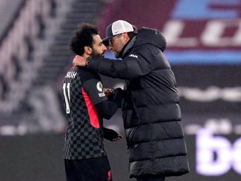 Jurgen Klopp, right, heaped praise on Mohamed Salah after he ended his goal drought (John Walton/PA)