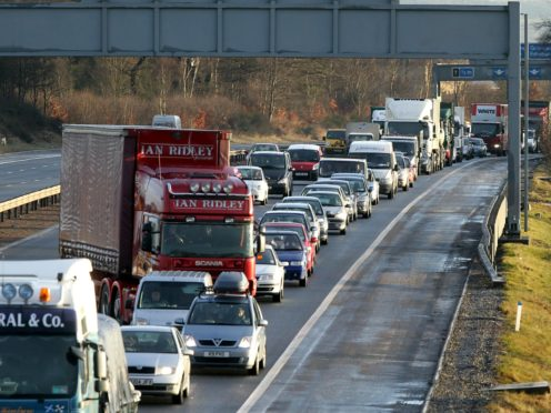 The Scottish Government needs more 'tough' policies to reduce emissions – particularly from vehicles – the Climate Change Committee has said (Andrew Milligan/PA)