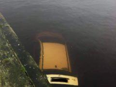 The Coastguard said the car had 'accidentally been driven off the quayside' (HM Coastguard/PA)