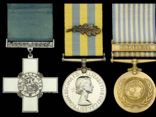 A George Cross won by Lt Terry Waters during the Korean War is expected to fetch up to £180,000 when it is sold at auction (Dix Noonan Webb/PA)