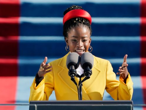 American poet Amanda Gorman reads a poem during the 59th presidential inauguration at the US Capitol in Washington (Patrick Semansky/AP/Pool)